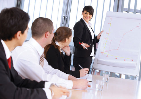 Lady Presenting To Colleagues