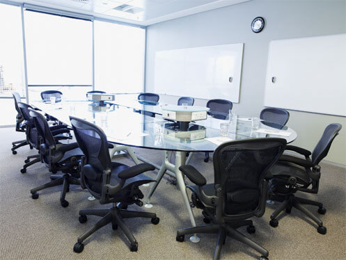 Board room meeting table with chairs